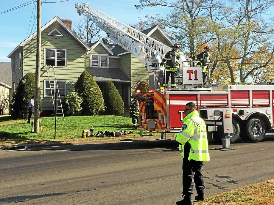 A dog and a cat died after a fire broke out at 6 Indian Neck Ave. in Branford late Tuesday morning. Photo: Wes Duplantier — New Haven Register