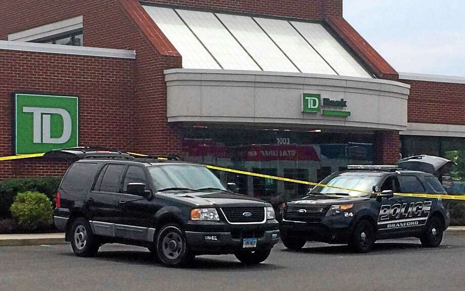 Police investigate a robbery at TD Bank on Route 1 in Branford Monday. Photo: Wes Duplantier — New Haven Register