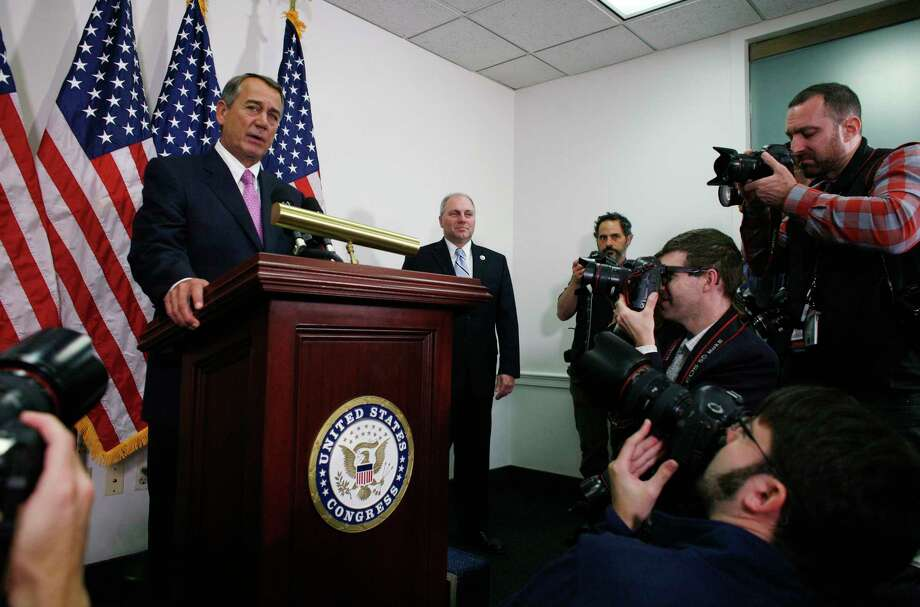 Outgoing House Speaker John Boehner of Ohio, accompanied by House Majority Whip Steve Scalise of La., right, talks with reporters on Capitol Hill in Washington on Oct. 27, 2015. House Republican leaders on Tuesday pushed toward a vote on a two-year budget deal despite conservative opposition, relying on the backing of Democrats for the far-reaching pact struck with President Barack Obama. Photo: AP Photo/Lauren Victoria Burke   / FR132934 AP