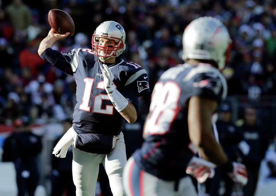 Patriots quarterback Tom Brady passes to running back James White (28) against the Titans last Sunday. Photo: The Associated Press File Photo   / AP