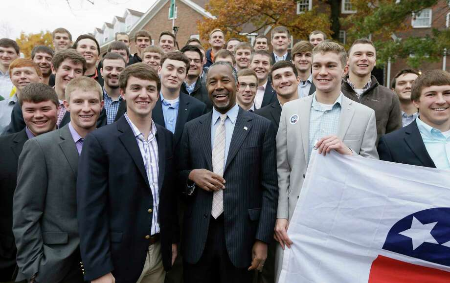 Republican presidential candidate Dr. Ben Carson poses for a photo with Alpha Gamma Rho fraternity members at Iowa State University following a campaign stop, Saturday, Oct. 24, 2015, in Ames, Iowa. Photo: AP Photo/Charlie Neibergall    / AP
