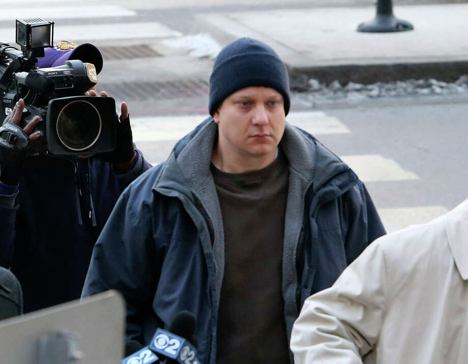 Chicago police officer Jason Van Dyke, accused of fatally shooting a black teenager, arrives at the Leighton Criminal Courthouse in Chicago on Tuesday, Nov. 24, 2015. Van Dyke was charged with first degree murder in the killing of 17-year-old Laquan McDonald. Photo: Antonio Perez/Chicago Tribune Via AP / Chicago Tribune