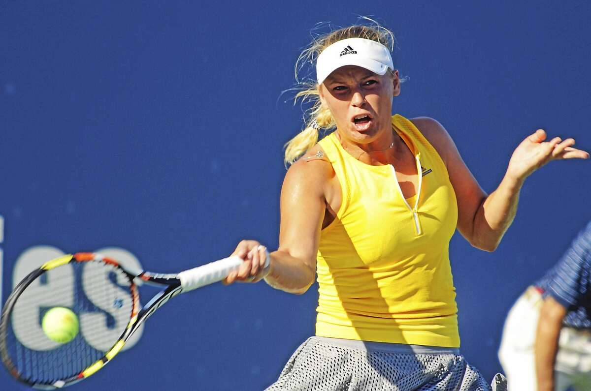 Caroline Wozniacki survived a third-set tiebreaker against Italian qualifier Roberta Vinci on Wednesday to advance to the quarterfinals of the Connecticut Open.
