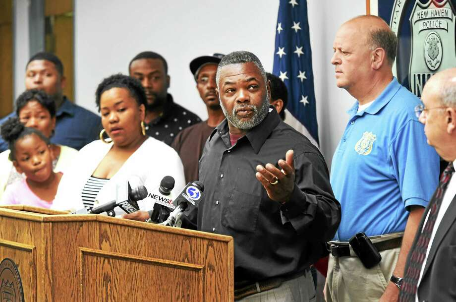 Kenneth Sellers shares his appreciation to the New Haven Police department for an arrest in the 2010 murder of his son Kenneth Thomas, 29, during a press conference at New Haven Police headquarters Monday. At far right is Assistant Police Chief Achilles Generoso, and police Chief Dean Esserman is second from right. Photo: Peter Hvizdak — New Haven Register   / ?2015 Peter Hvizdak
