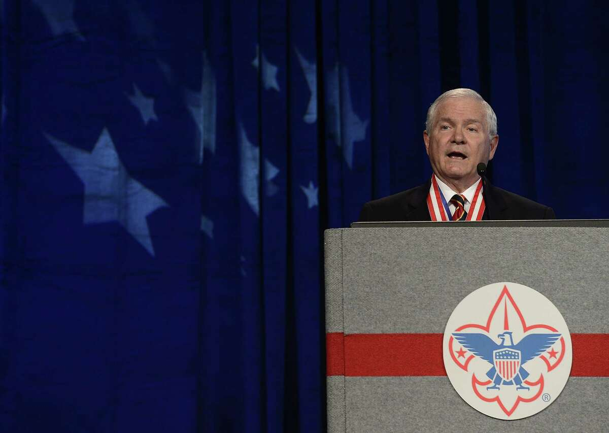 In this May 23, 2014 photo, former Defense Secretary Robert Gates addresses the Boy Scouts of America's annual meeting in Nashville, Tenn., after being selected as the organization's new president.