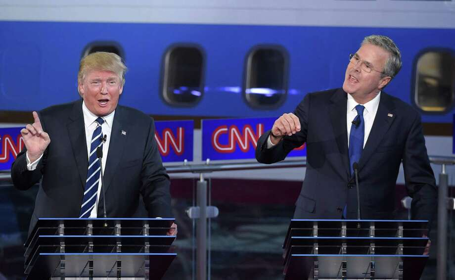 Republican presidential candidates former Florida Gov. Jeb Bush, right, and Donald Trump both speak during the CNN Republican presidential debate at the Ronald Reagan Presidential Library and Museum in Simi Valley, Calif. The two GOP debates have attracted record-setting audiences for Fox News Channel and CNN. Photo: AP Photo   / AP