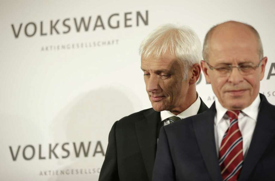 Newly appointed Volkswagen CEO Matthias Mueller, left, passes by Berthold Huber, acting chairman of the supervisory board, prior to a press statement after a meeting of Volkswagen's supervisory board in Wolfsburg, Germany, Friday, after CEO Martin Winterkorn resigned on Wednesday amid an emissions scandal. Photo: AP Photo   / AP