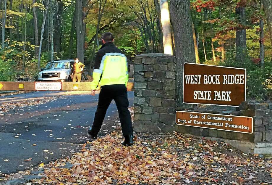 New Haven fire crews leave West Rock Ridge State Park late Monday morning after recovering the body of Robert Anastasio, 26, of Hamden, who fell there Sunday evening and died. Photo: Wes Duplantier — New Haven Register