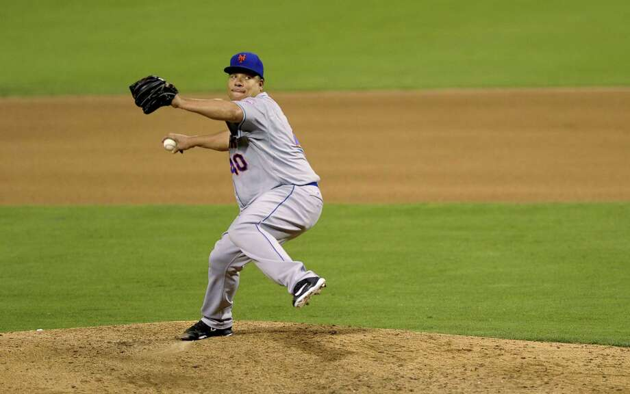New York Mets starter Bartolo Colon pitches in the sixth inning of Wednesday's game against the Phillies in Philadelphia. Photo: Michael Perez — The Associated Press   / FR168006 AP