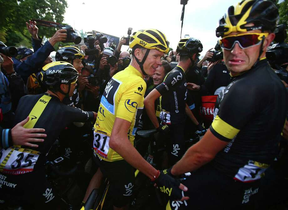 Britain's Chris Froome celebrates with his Sky teammates after winning the Tour de France cycling race in Paris, France on July 26, 2015. Photo: AP Photo/Laurent Rebours   / AP