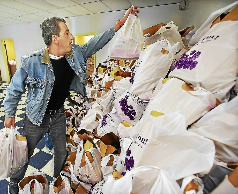 Employee Tom Andrea at the fourth annual BlumShapiro Thanksgiving Basket Campaign, Saturday, November 21, 2015,. Photo: (Catherine Avalone - New Haven Register) / New Haven RegisterThe Middletown Press