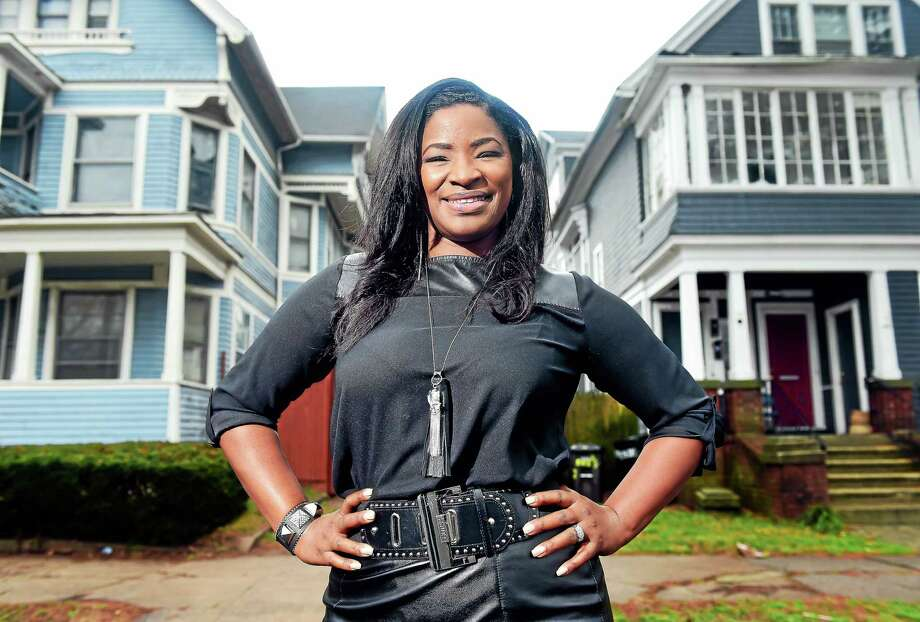 Roberta Hoskie, President and CEO of Outreach Realty Services, is photographed in front of the first house she purchased at 283 Norton St. (left) in New Haven on Dec. 24, 2015.  She no longer owns this home. Photo: Arnold Gold — New Haven Register