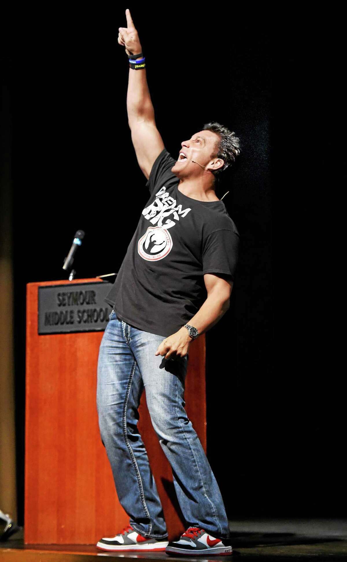 Former professional wrestler Marc Mero delivers an inspirational talk to Seymour Middle School students Tuesday about life choices, bullying and the importance of dreams and goals.