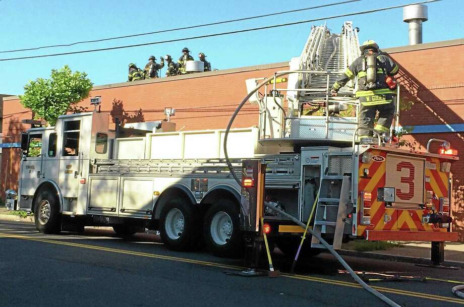 New Haven firefighters extinguished a small fire Wednesday morning at Chabaso Bakery in New Haven. Photo: Wes Duplantier — New Haven Register