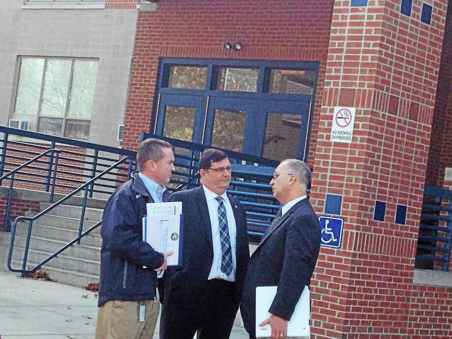 West Haven Mayor Ed O'Brien, center, Finance Director Kevin McNabola and Corporation Council Vin Amendola talk in front of West Haven High School after Tuesday's meeting with state officials. Photo: Mark Zaretsky — New Haven Register