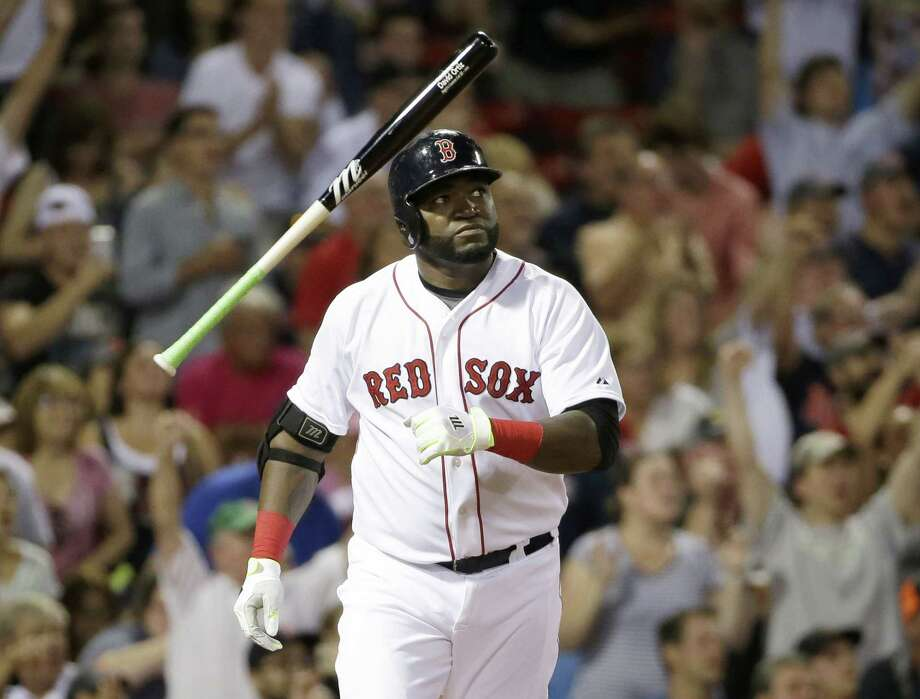 David Ortiz tosses the bat as he watches the flight of his three-run home run in the fifth inning Sunday against the Tigers. Photo: Steven Senne — The Associated Press   / AP