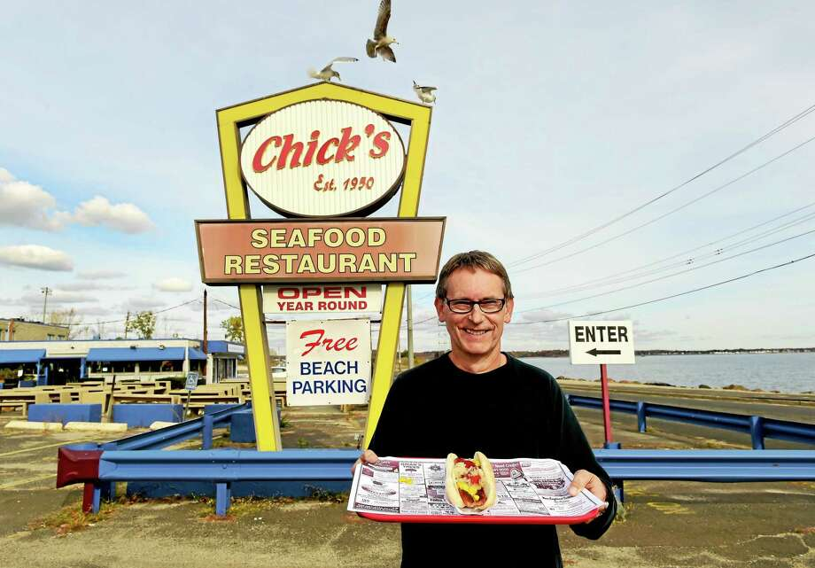 Peter Hvizdak — New Haven RegisterJoseph Celentano proudly shows off a trademark long hot dog in front of Chick's Drive-In on Beach Street in West Haven Thursday. Photo: ©2015 Peter Hvizdak / ©2015 Peter Hvizdak