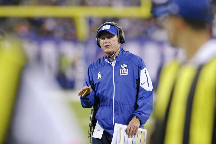 Giants head coach Tom Coughlin talks to an official during the first half of Thursday's game against Washington. Photo: Bill Kostroun — The Associated Press   / FR51951 AP