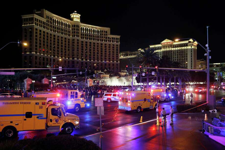 FILE - In this Dec. 20, 2015 file photo, police and emergency crews respond to the scene of a car accident along Las Vegas Boulevard in Las Vegas. Business, Academic and elected leaders are both suggesting fixes and defending the work done so far to keep pedestrians safe after a woman drove her car into a crowd of tourists outside the Planet Hollywood and Paris casino-hotels. Photo: AP Photo/John Locher, File / AP