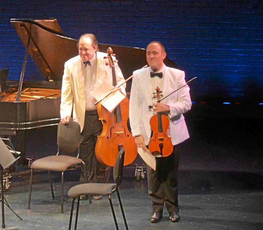 Contributed  Cellist and Artistic Director Ronald Thomas and violist Mark Holloway take a bow after a previous performance at The Kate. Photo: Journal Register Co.