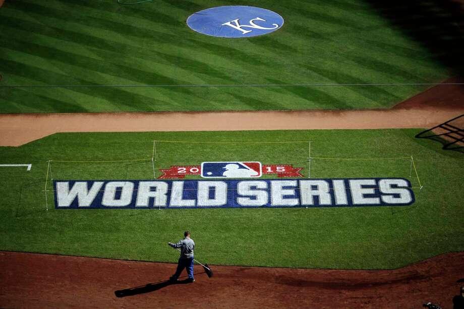 A worker gets Kauffman Stadium ready for the World Series Monday in Kansas City, Mo. Photo: David Goldman — The Associated Press   / AP