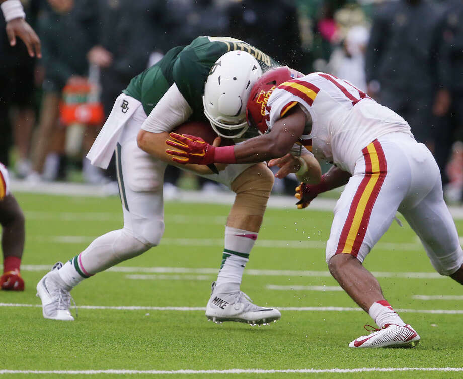 Baylor quarterback Seth Russell, left, is stopped by Iowa State defensive back Jomal Wiltz on Saturday in Waco, Texas. According to team officials, Russell suffered a fractured bone in his neck on the play. Photo: Rod Aydelotte — Waco Tribune-Herald   / Waco Tribune Herald