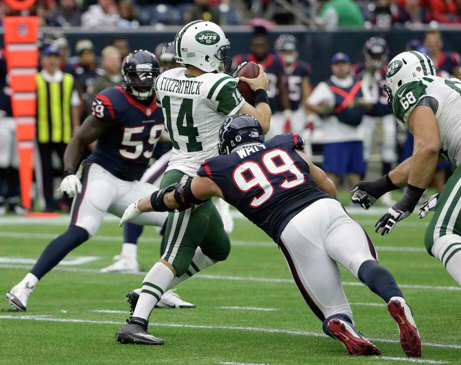 New York Jets quarterback Ryan Fitzpatrick is sacked by Texans defensive end J.J. Watt during the first half of Sunday's game in Houston. Photo: David J. Phillip — The Associated Press   / AP