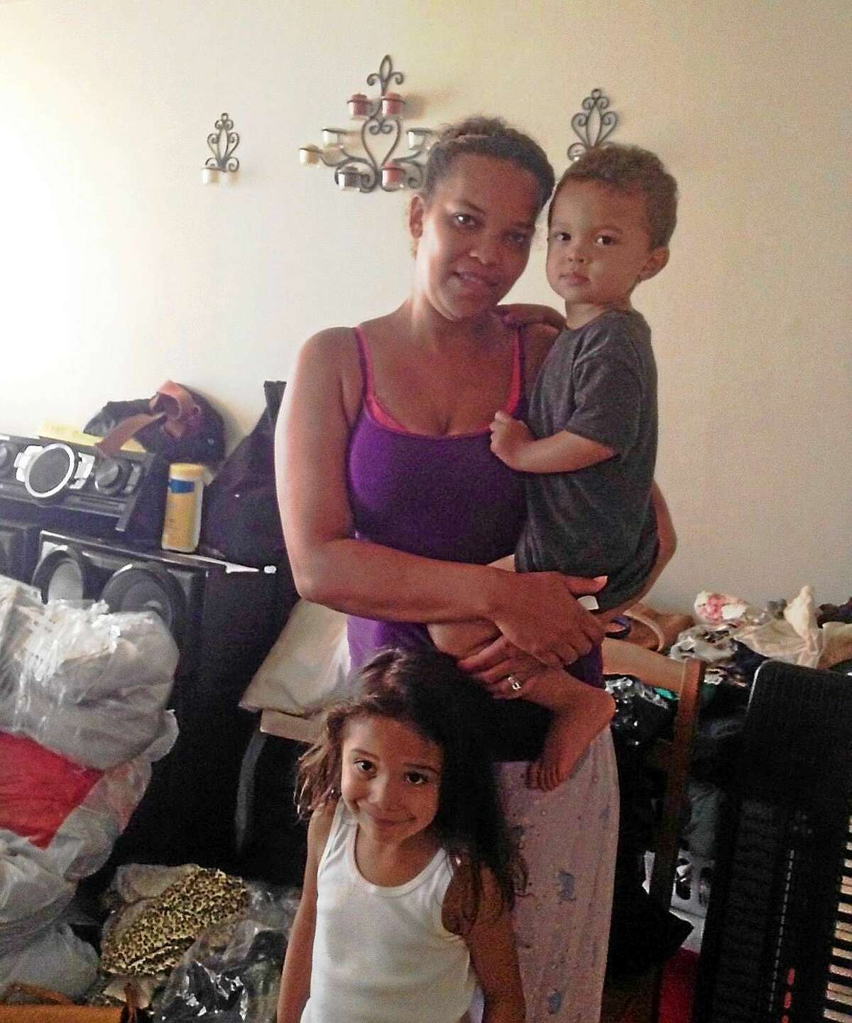 Yomaly Rivera holds her 2-year-old son, Yadier. Her 4-year-old daughter is Thatiana. She wants to be moved out as their apartment is repaired at 97A Columbus Ave. in New Haven.
