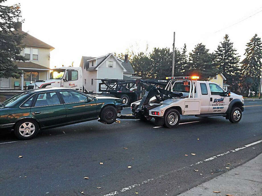 A car is towed from the scene after the driver hit two pedestrians on Hemingway Avenue in East Haven on Monday, Nov. 23, 2015. Photo: (Wes Duplantier -- New Haven Register)