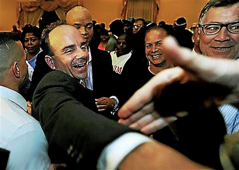 In this Nov. 3, 2015 photo, Democrat Joe Ganim celebrates after being elected mayor of Bridgeport, Conn. The story of Ganim's re-election, an ex-convict who spent seven years in federal prison for corruption, was among the top stories in Connecticut for 2015. Photo: Brian A. Pounds/Hearst Connecticut Media Via AP, File