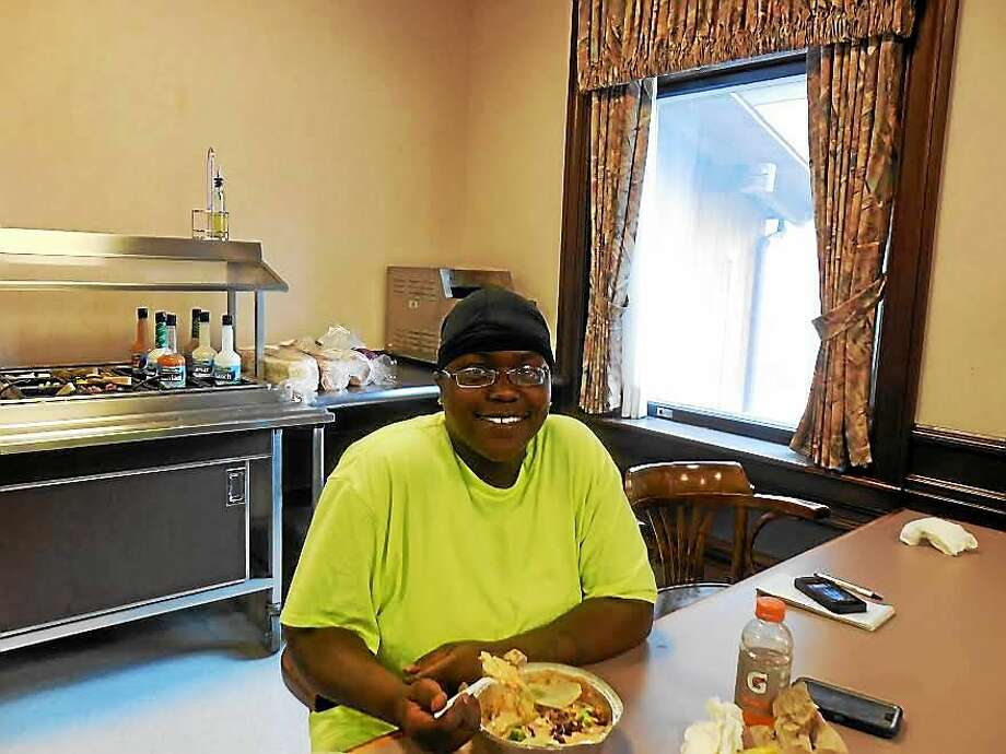Adashia Bailey takes her lunch break at the New England Laborers Training Academy where a four-week course was under way. Mary E. O'Leary photo Photo: Journal Register Co.