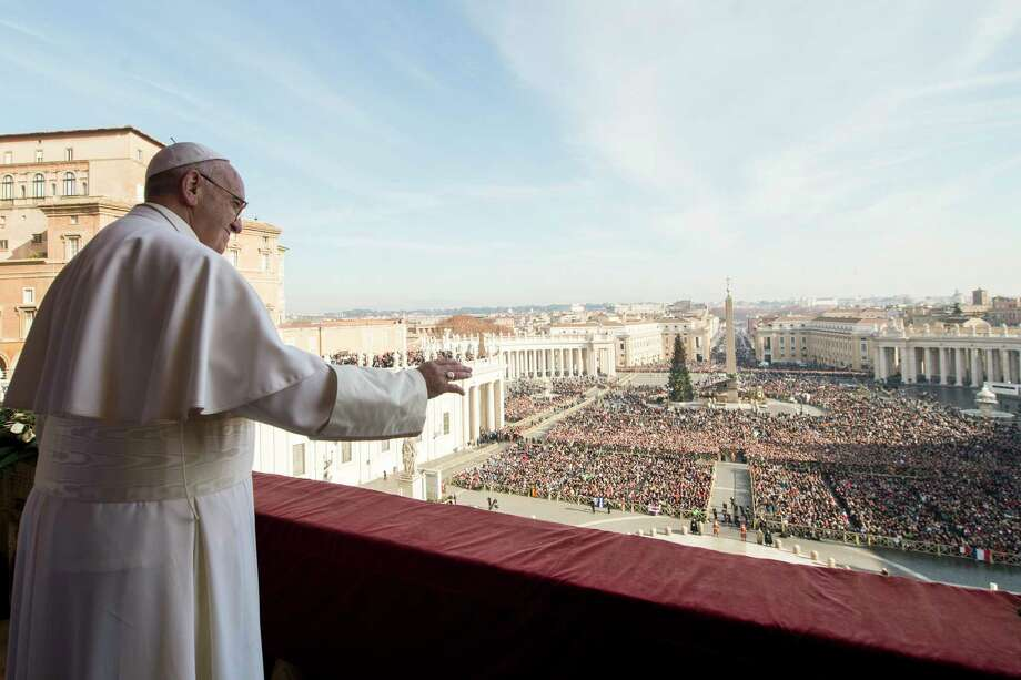 """Pope Francis delivers his """"Urbi et Orbi"""" (to the city and to the world) blessing from the central balcony of St. Peter's Basilica at the Vatican on Dec. 25, 2015. Photo: L'Osservatore Romano/Pool Photo Via AP   / L'Osservatore Romano"""
