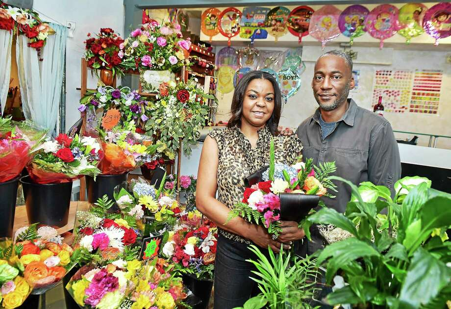 (Catherine Avalone - New Haven Register)   New Haven residents Carrien and Chris Davis, owners of Any Occasion Creation, designs unique silk and fresh floral arrangements for all occassions, at 847 Whalley Avenue in New Haven. The Davis' moved just a block to their present location in December 2014, and continue to build their customer base. Visit their website at www.AnyOccasionCreation.biz or stop by  Monday thru Saturday from 10 a.m. to 7 p.m. Photo: Journal Register Co. / New Haven RegisterThe Middletown Press