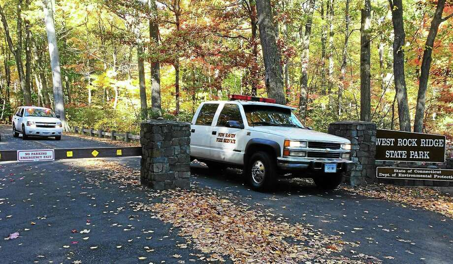 New Haven fire crews leave West Rock Ridge State Park late Monday morning after recovering the body of a man who fell there Sunday evening. Photo: Wes Duplantier — New Haven Register