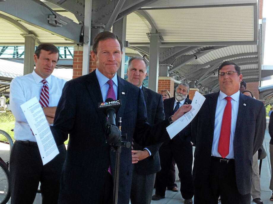 U.S. Sen. Richard Blumenthal, D-Conn, talks Wednesday about the $973,834 Federal Highway Administration grant that will pay for West Haven railroad station improvements including a bike path to Yale University's West Campus. With him, from left, are U.S. Sen. Chris Murphy, D-Conn., Yale Vice President for West Campus Planning & Program Development Scott Strobel, state Rep. Charles Ferraro, R-West Haven (at rear), and Mayor Ed O'Brien. Photo: Contributed Photo