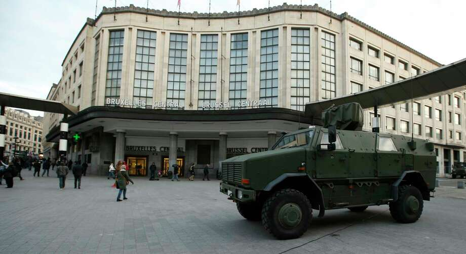 A Belgian army armoured vehicle stands parked in front of the central railway station in Brussels, Monday, Nov. 23, 2015. Three days of the highest terror alert and unprecedented measures that have closed down the city's subways, schools and main stores, has created a very different atmosphere as the Belgian capital tries to avoid attacks similar to the ones that caused devastating carnage in Paris. Photo: AP Photo/Alastair Grant   / AP