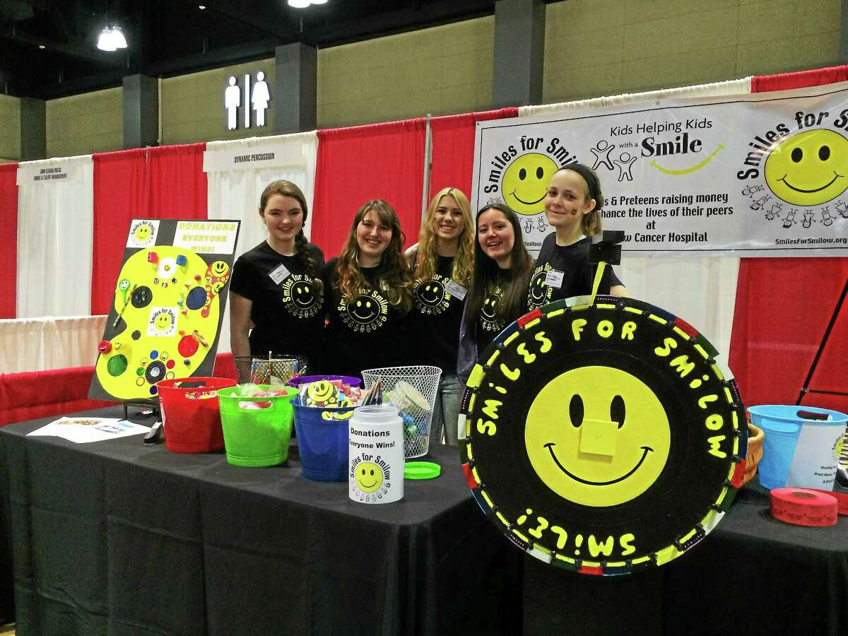 Photo courtesy of Lexi Minutillo Lexi Minutillo (second from left) with members of her Smiles for Smilow organization at a charity event.