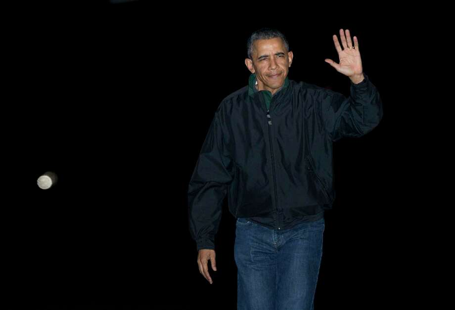 President Barack Obama waves as he arrives at the White House in Washington, Monday from a nine-day trip to Turkey, Philippines and Malaysia. Photo: Manuel Balce Ceneta — The Associated Press   / AP