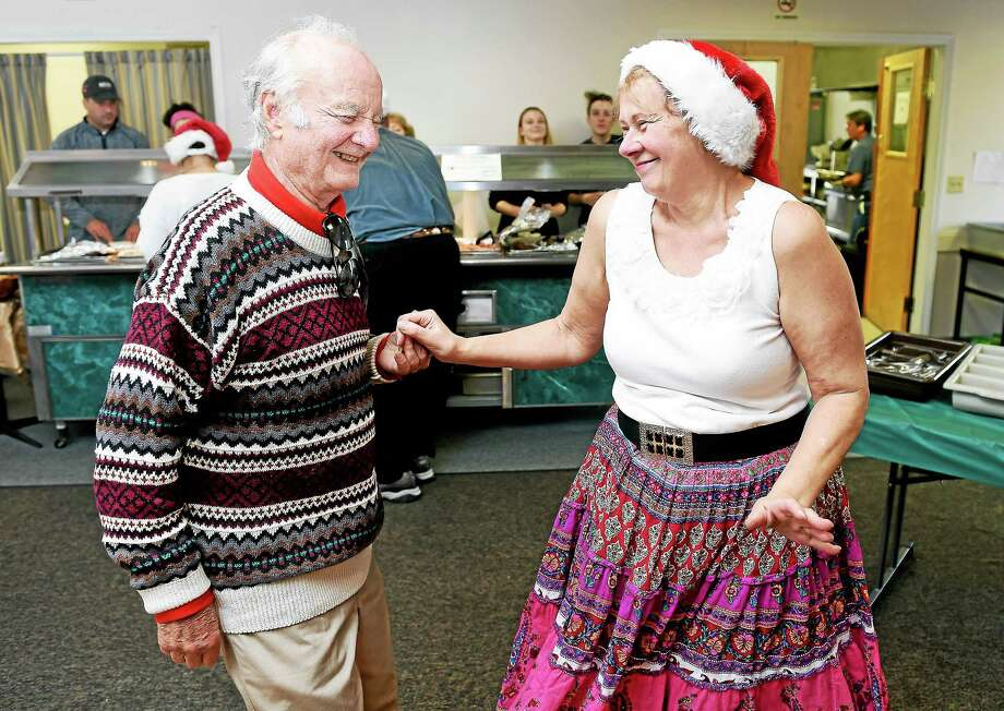 (Arnold Gold-New Haven Register)  Lor Cubbison (left) of Milford dances with Kathy Brzezinski of Milford at the annual Milford Elks Lodge Christmas dinner on 12/25/2015. Photo: Journal Register Co.