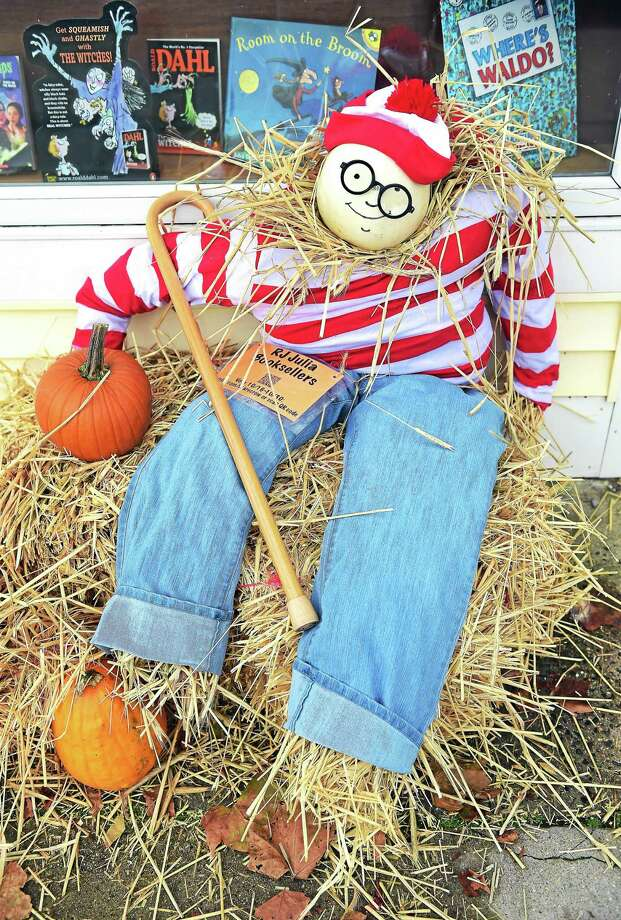 Seasonal festive feelings are found in many communities. Here. a Waldo scarecrow is displayed outside of R.J. Julia Booksellers In Madison   Town businesses in Madison have made and displayed scarecrows as part of the Sea, Shop, Scare! event organized by the Madison Chamber of Commerce. Photo: (Arnold Gold-New Haven Register)