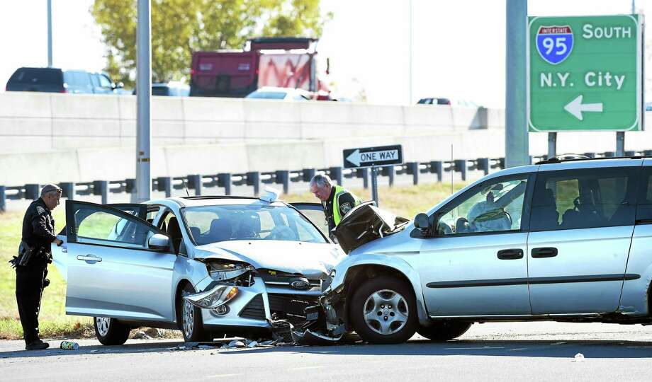 A car and a minivan collided by the southbound Interstate 95 Exit 46 exit ramp on Sargent Drive in New Haven Monday. Photo: Arnold Gold — New Haven Register