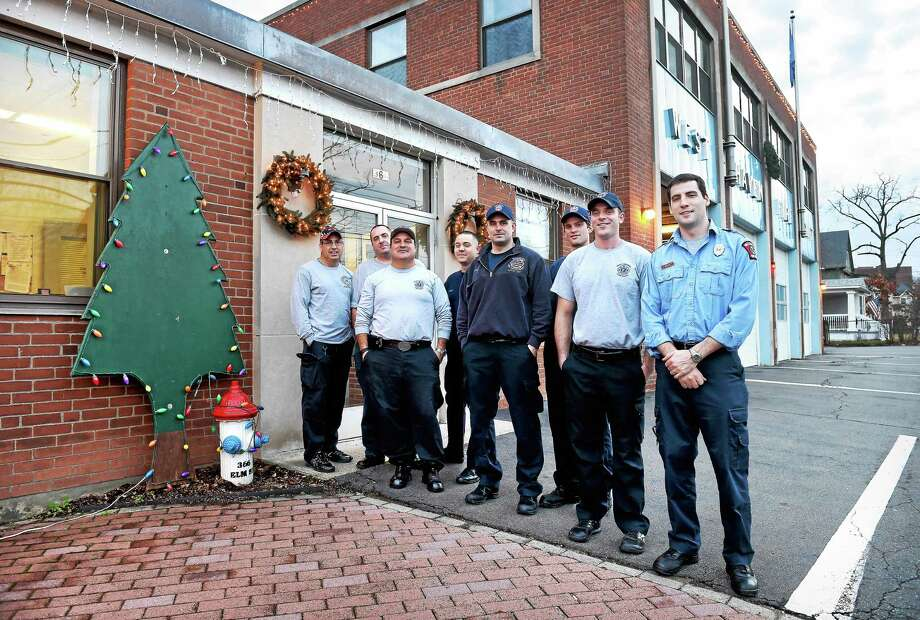 (Arnold Gold-New Haven Register)  The crew working Christmas at the West Haven Central Fire Station photographed on 12/25/2015. Photo: Journal Register Co.
