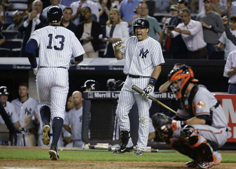 The Yankees' Mark Teixeira, right, greets Alex Rodriguez as he crosses the plate after hitting a home run against the Baltimore Orioles on Wednesday in New York. Photo: Julie Jacobson — The Associated Press   / AP