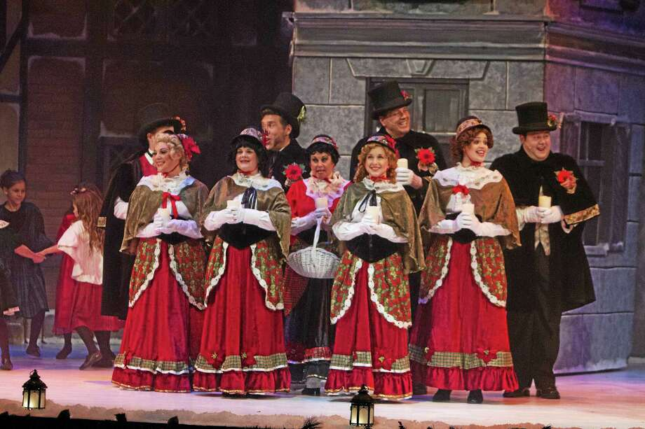 """Shubert Theatre  A choir sings familiar tunes in """"A Christmas Carol"""" at the Shubert Theatre in New Haven. Photo: Journal Register Co. / Jeff Dachowski"""