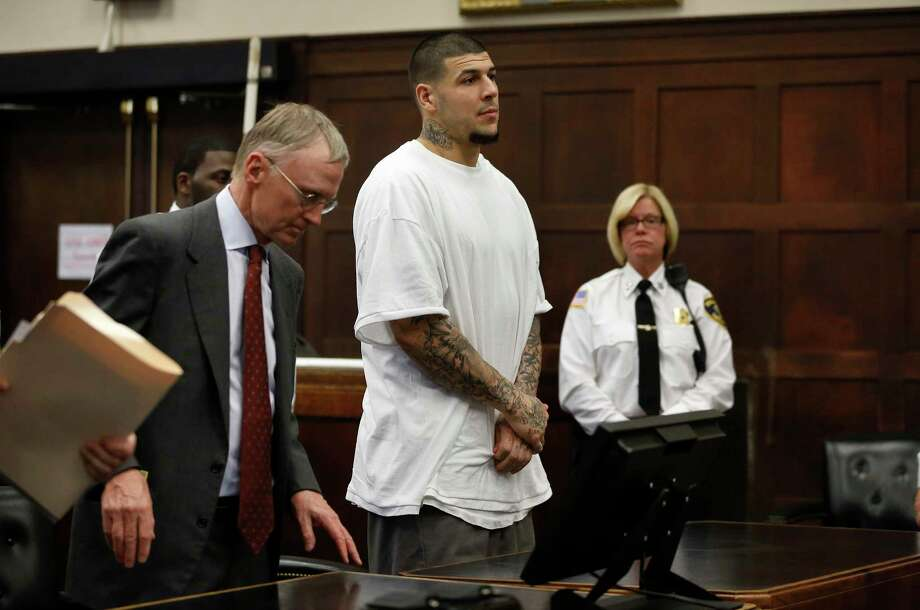 Former New England Patriots NFL football player Aaron Hernandez, center, stands with defense attorney Charles Rankin, left, at the conclusion of a pre-trial hearing at Suffolk Superior Court, Tuesday, Dec. 22, 2015, in Boston. Hernandez is charged with killing two Boston men in 2012 after a chance encounter at a nightclub. Photo: AP Photo/Steven Senne, Pool / POOL AP