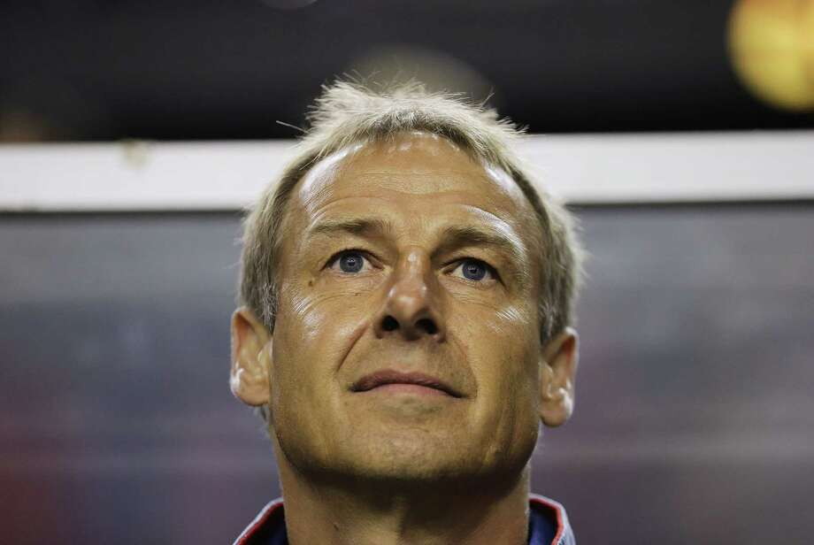 United States head coach Jurgen Klinsmann waits for the start of a CONCACAF Gold Cup semifinal match against Jamaica on Wednesday. Photo: David Goldman — The Associated Press   / AP