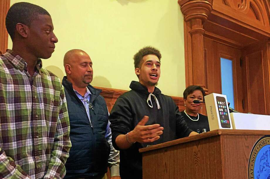 Jean Calcano, center, a senior at New Light High School in New Haven, talks about his experience in city's first YouthStat summer school program, Monday at City Hall. Photo: Esteban L. Hernandez — New Haven Register