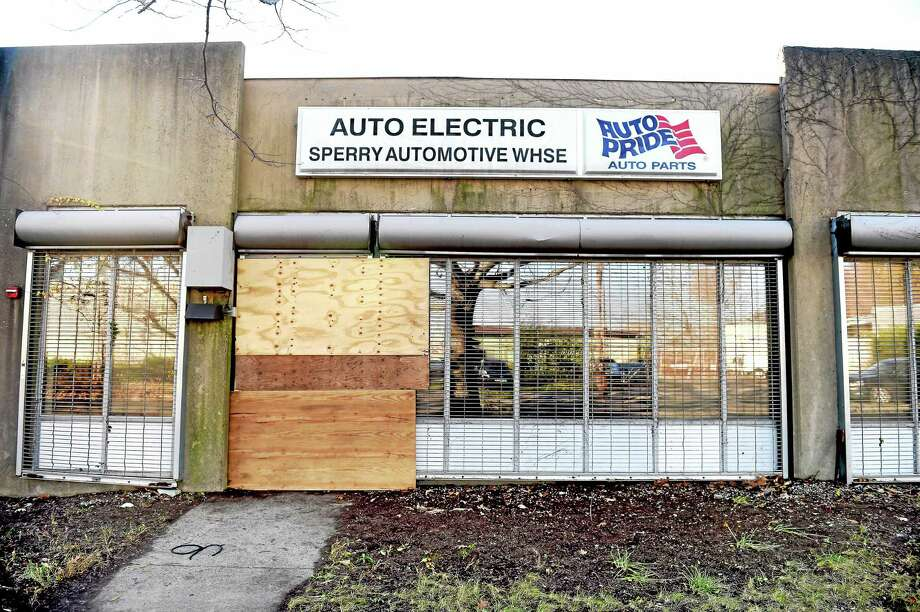 Federal, state and local environmental officials descended on a former auto supply business at 206 Wallace St. Monday in New Haven. Photo: Arnold Gold — New Haven Register