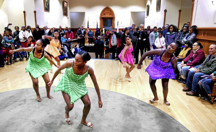 Members of the Hamden Academy of Dance & Music perform at the 10th annual Kwanzaa Ceremony at City Hall in New Haven in 2014. Photo: Arnold Gold — New Haven Register