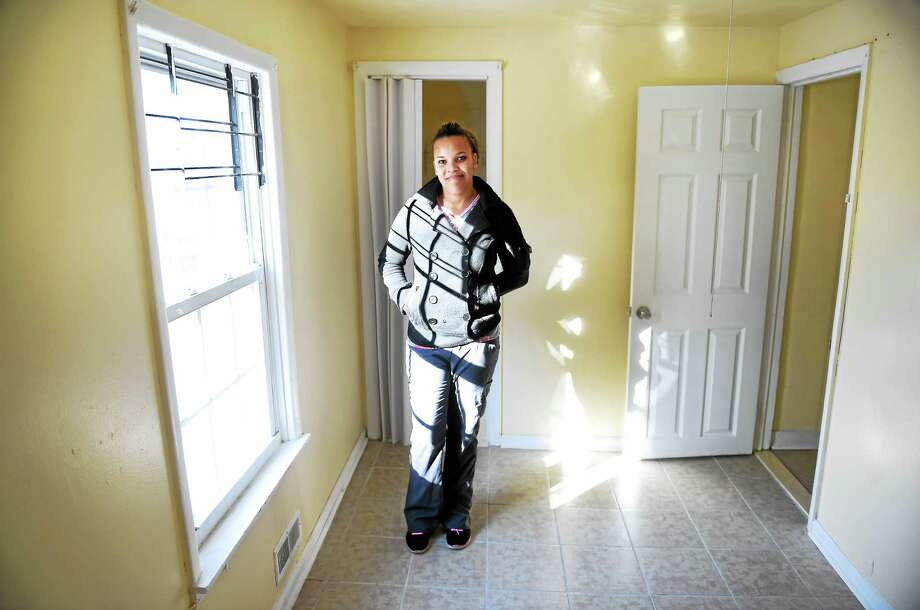 Yomaly Rivera is photographed in one of the bedrooms in her new home on Tyler Street in New Haven Monday. Photo: Arnold Gold — New Haven Register